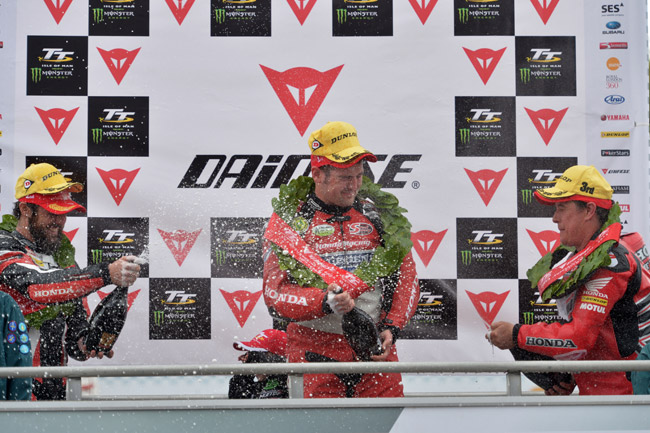 The Isle of Man Superbike podium placers share the champagne. Image: IOMTT.com.
