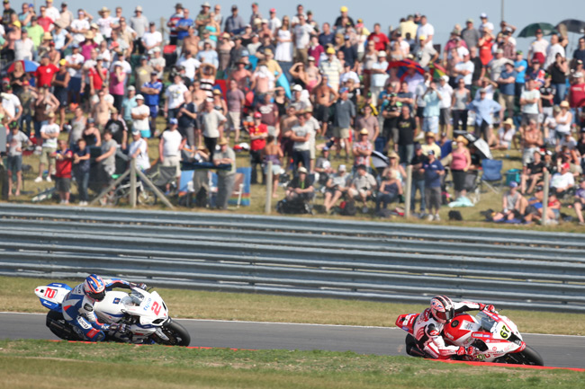 Josh Brookes had a late lunge at Shane Byrne in the second race but couldn't find a way past.
